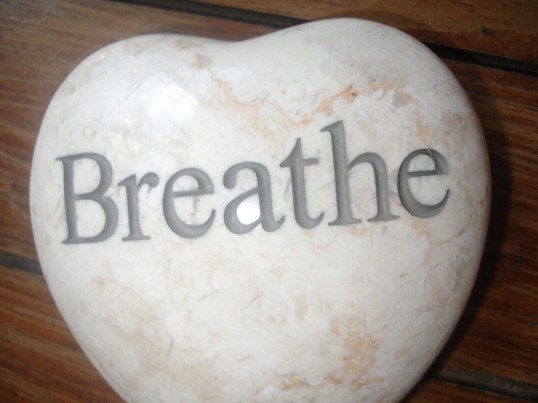 Breathe etched on stone heart